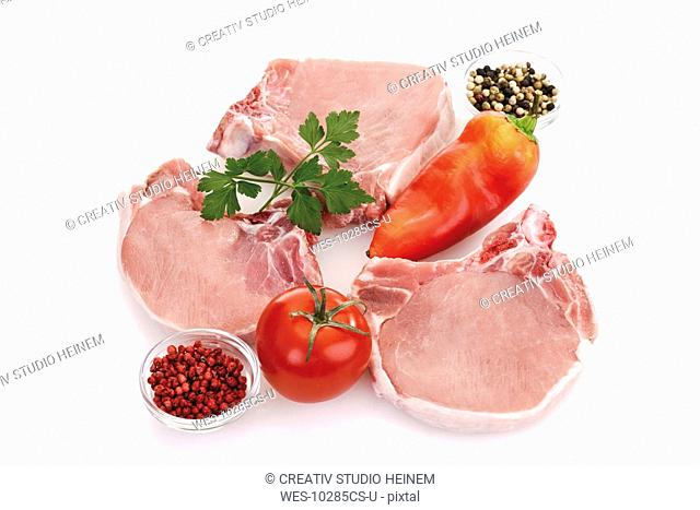 Raw Porkchops, vegetable and spices, elevated view