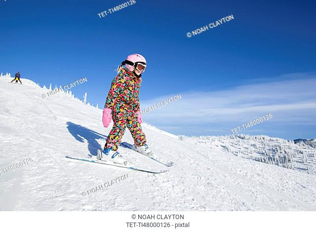 Girl (8-9) skiing in mountains