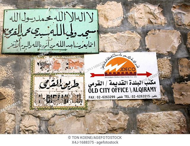 Arabic signs hang in a market in the old city section of Jerusalem