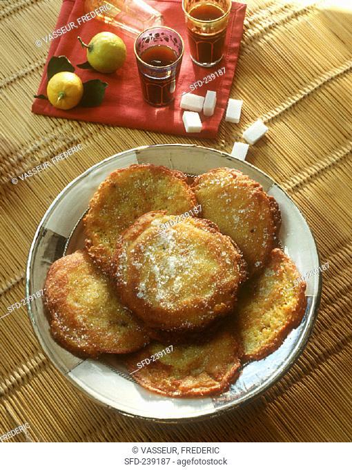 Tunisian sweet fritters, sugar lumps, lemons