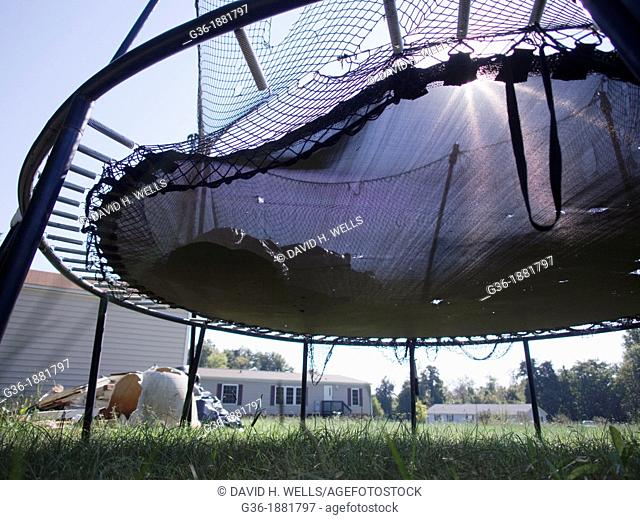 Trampoline left outside of a foreclosed house in Burlington, North Carolina