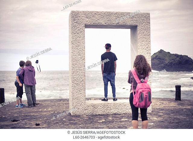 Tourist in Garachico, Tenerife, Canary islands, Spain.çTensei Tenmoku ('Door without Door') by Japanese artist Kan Yasuda