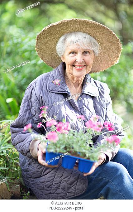 Portrait of senior woman, aged 77, in her garden