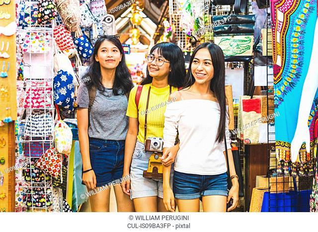 Tourists walking in bazaar, Bangkok, Thailand
