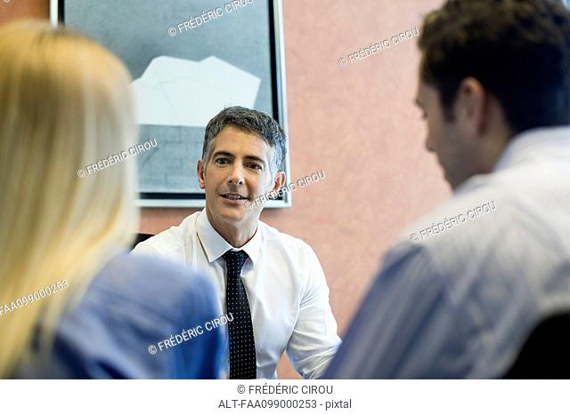 Insurance agent meeting with prospective clients