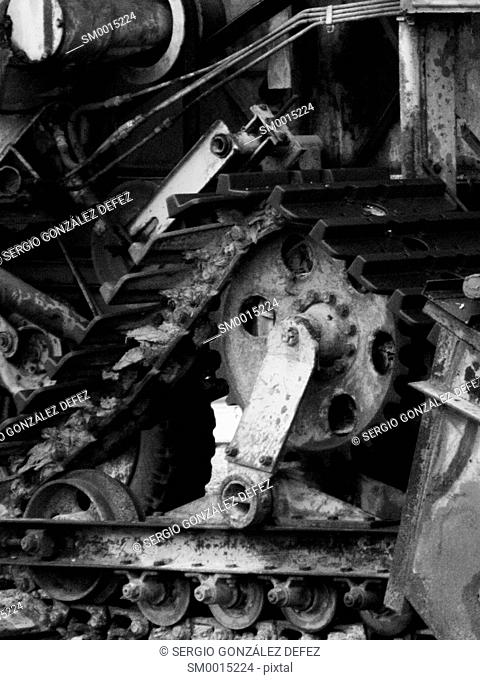 Wheel and several gears of machine of agriculture ancient. Image in black and white