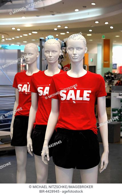 Mannequin with t-shirts displaying Sale