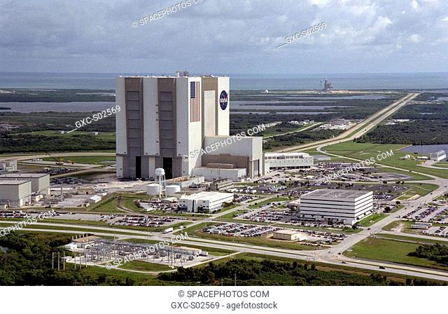 An aerial view of the Launch Complex 39 area shows the Vehicle Assembly Building center, with the Launch Control Center on its right