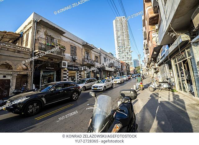 Eilat Street in Florentin neighborhood, Tel Aviv city, Israel. Neve Tzedek Tower on background