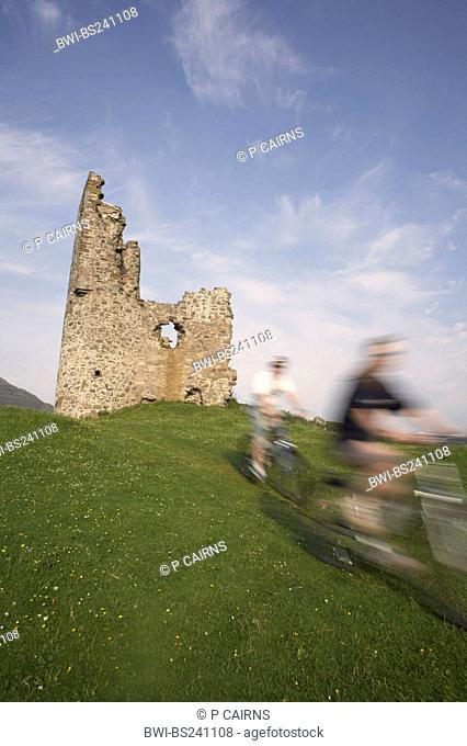 two mountain bikers passing Ardvreck Castle, United Kingdom, Scotland, Sutherland