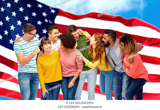 diversity, race, ethnicity and people concept - international group of happy men and women laughing over american flag background