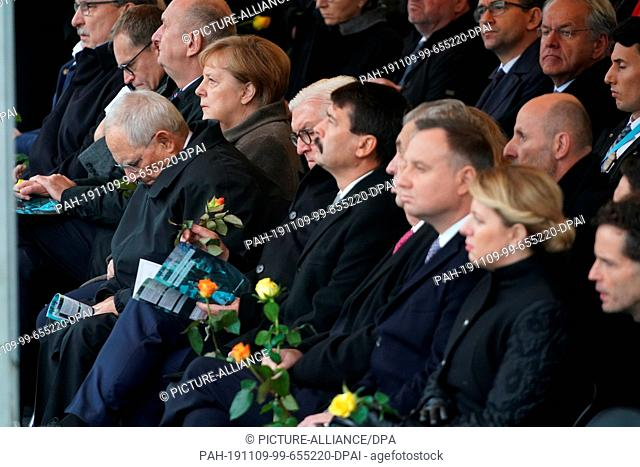 09 November 2019, Berlin: Federal Chancellor Angela Merkel (CDU, l-r), President of the Bundestag Wolfgang Schäuble, Federal President Frank-Walter Steinmeier