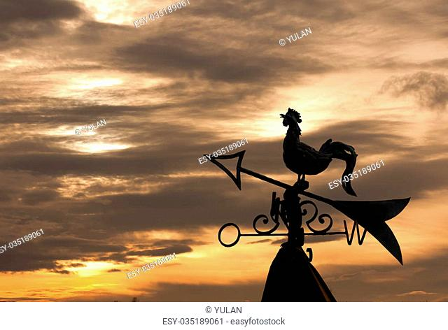 Weathercock silhouette in sunset