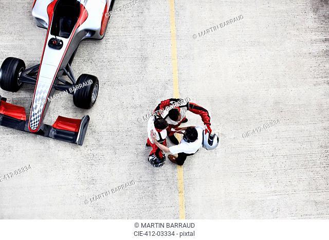 Racing team hugging on track