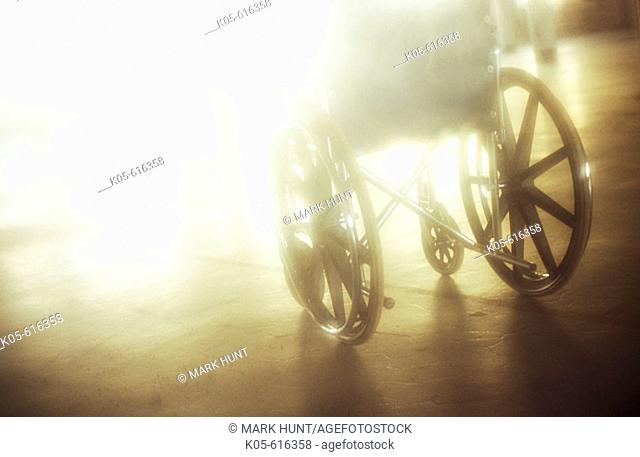 Empty wheelchair bathed in sunlight