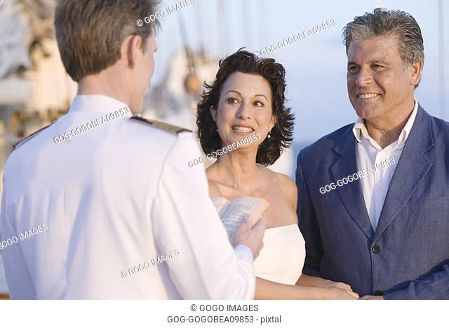 Couple getting married on boat deck