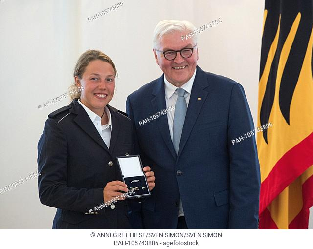 Federal President Frank-Walter STEINMEIER honors biathlete Laura DAHLMEIER (Garmisch-Partenkirchen). Awarded the Silver Laurel Leaf and the Order of Merit by...