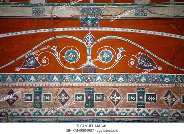 The fragment, from Herculaneum, is a typical example of decoration in the mature 3rd Style. The architectural motifs are traced against the black and bright red...