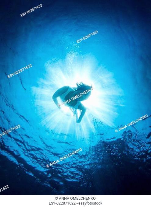 Woman dive into the sea