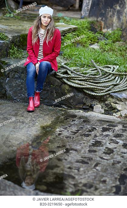 Young woman, Port, Mutriku, Gipuzkoa, Basque Country, Spain