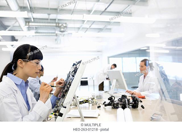 Engineer assembling computer parts