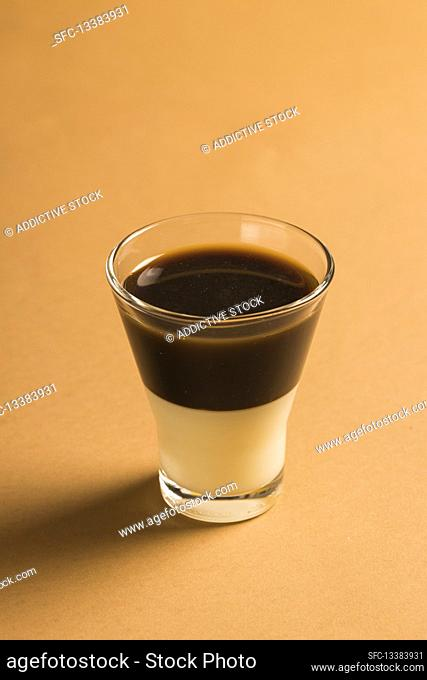 Layered coffee Bombon drink with espresso and sweetened condensed milk