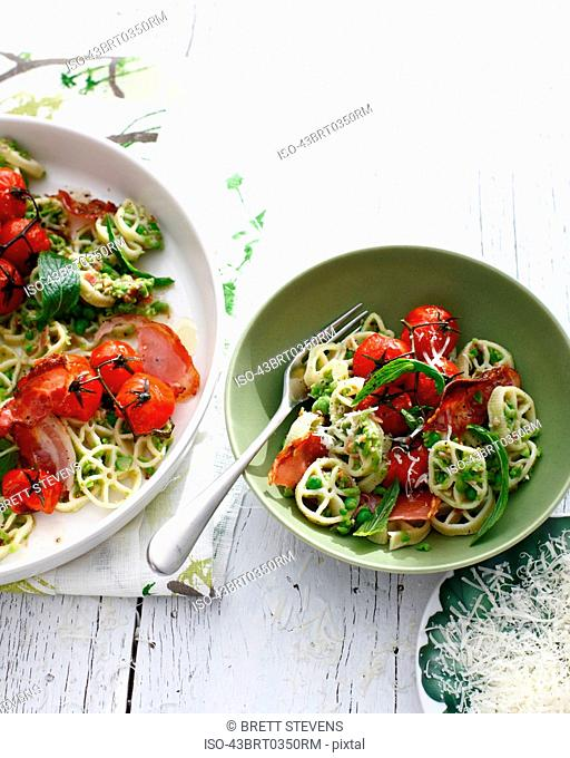 Bowls of tomato and herb pasta