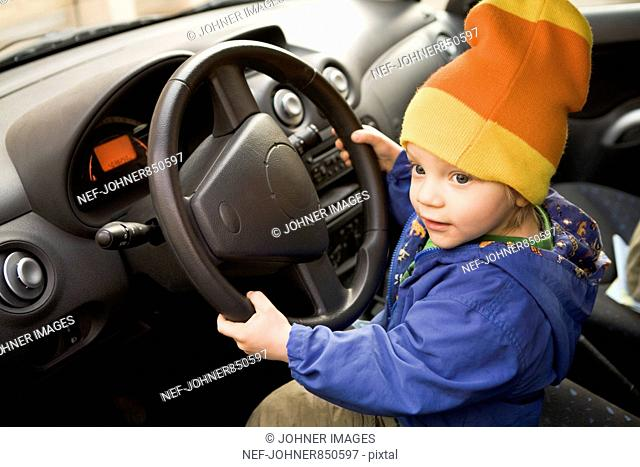 Boy in a car, Sweden