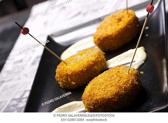 Chicken croquettes with cucumber sauce