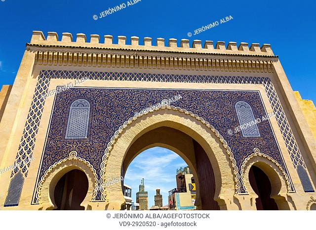 Street life scene. Bab Bou Jeloud gate, main entrance to Souk Medina of Fez, Fes el Bali. Morocco, Maghreb North Africa