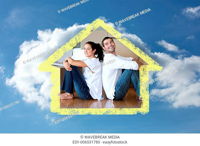 Composite image of radiant couple with unpacking boxes moving to a new house