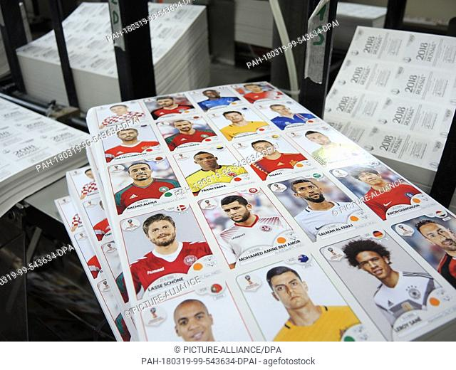 12 March 2018, Italy, Modena: Stacks of sticker sheet are made at a Panini sticker production facility. From 27 March, the stickers will be available inGerman...