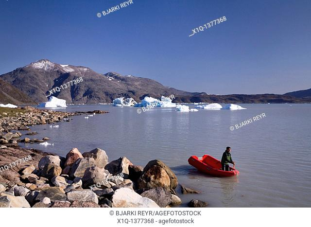 Man on his boat  Inneruulalik Farm, South Greenland