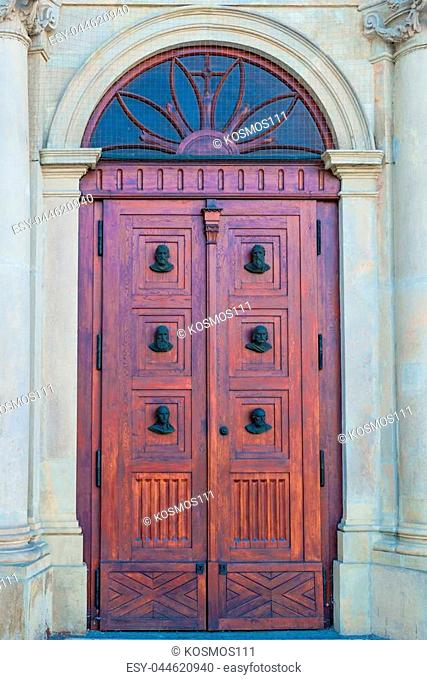 vertical photo of a close-up of a building door