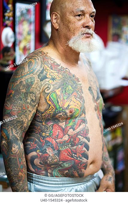 Bare chested man with tattoos