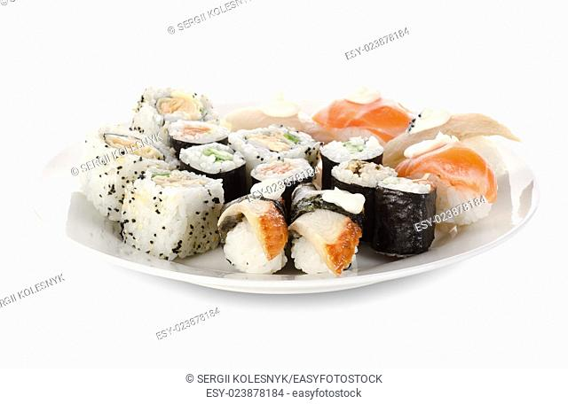 Sushi and rolls in a dishes isolated on a white background. Clipping path