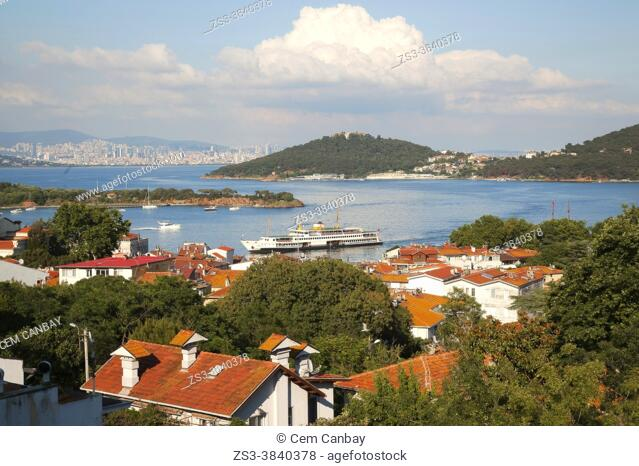 View from a hill in Burgazada, ancient Antigoni to the Heybeliada-Halki with a traditional ferry in the foreground, Prince Islands, Istanbul, Marmara Region