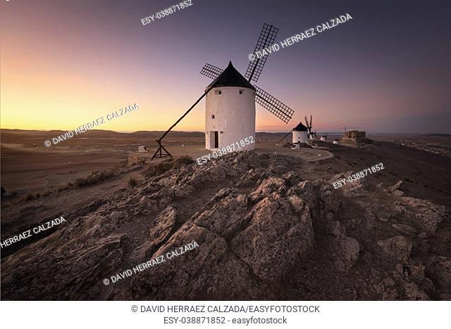Don Quixote windmills at sunset. Famous landmark in Consuegra, Toledo Spain