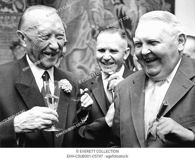 West German Chancellor Konrad Adenauer (left), and Chancellor designate Ludwig Erhard. Sept. 25, 1963. They were attending Adenauer's retirement party at the...