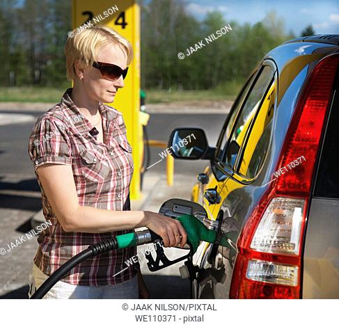 woman getting gas