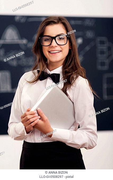 Happy female teacher in classroom Debica, Poland