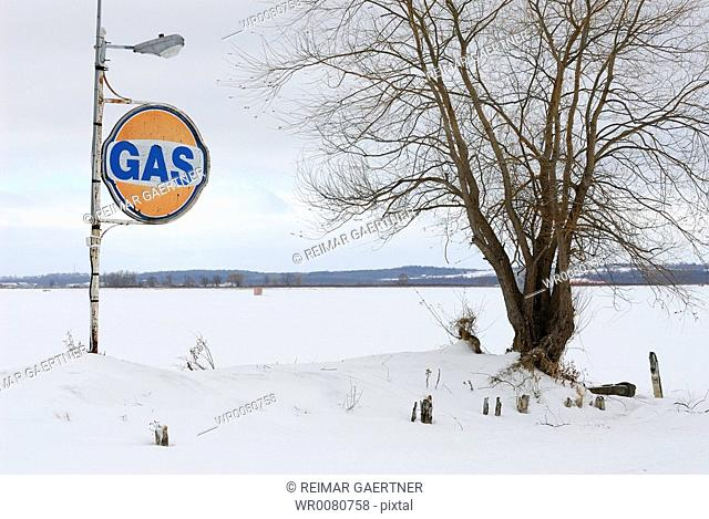 Abandoned gas station in winter by the Lake
