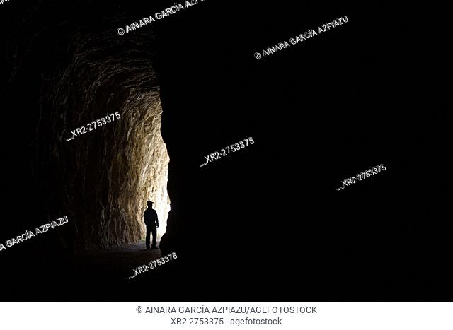 Man walking through the tunnel of Foz de Lumbier