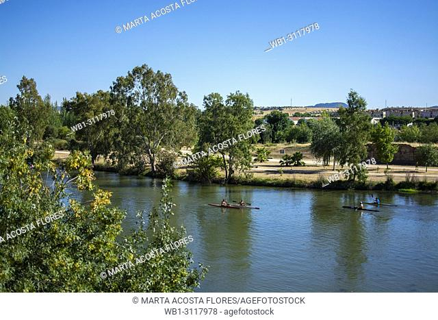 People practising canoeing in River Guadiana in a summer day. Merida, Extremadura, South of Spain