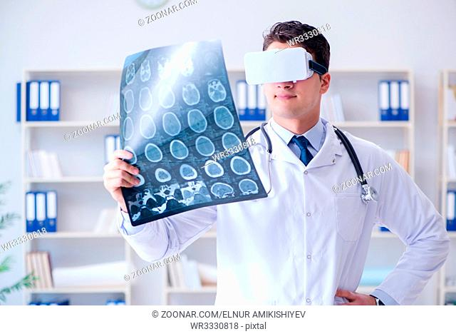 Young doctor looking at MRI scan through VR glasses