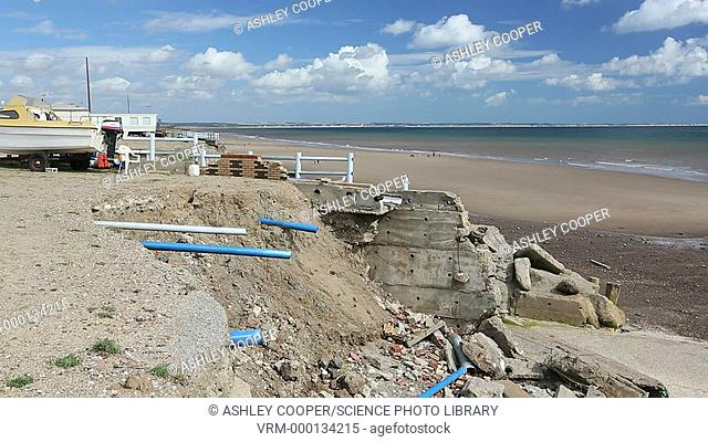 Smashed concrete sea defences at Beach Bank Caravan Park in Ulrome near Skipsea on Yorkshires East Coast, UK. The coast is composed of soft boulder clays