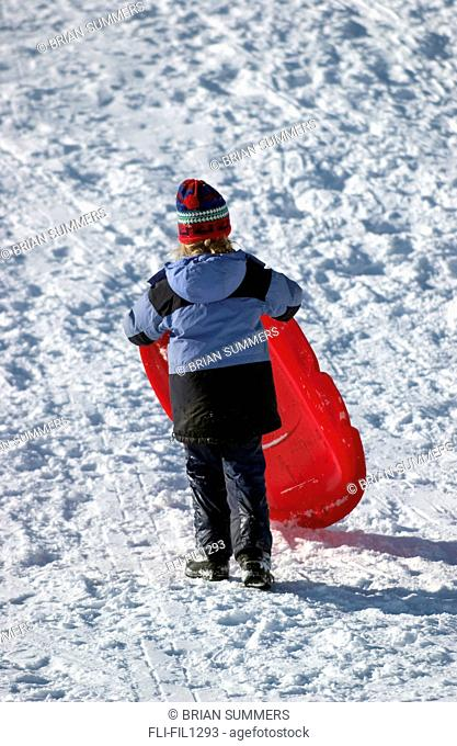 Girl Carrying Sled back up Hill
