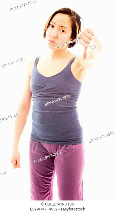 Young woman showing thumbs down sign