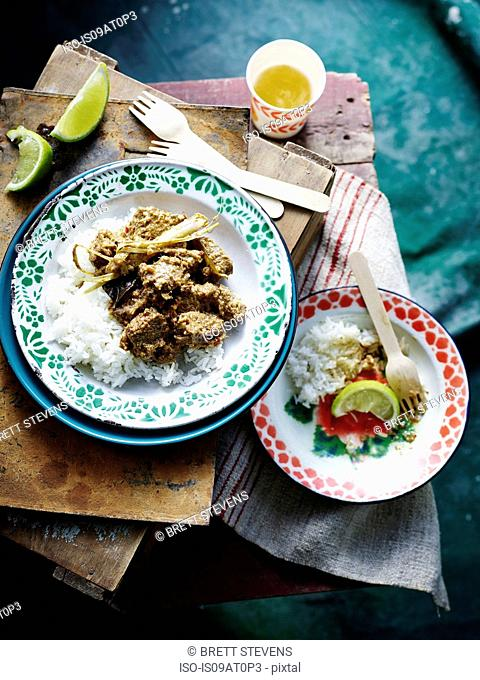 Overhead view of Malaysian Beef Rendang on enamel plate