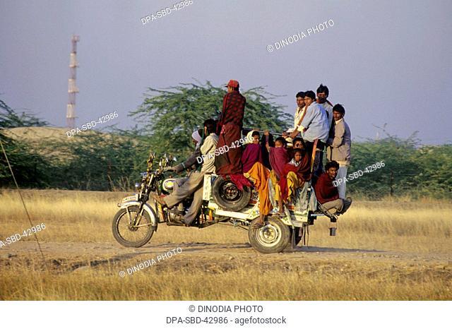 Auto rickshaw carrying people at gujarat India